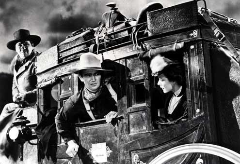 La Chevauchée fantastique : photo George Bancroft, John Ford, John Wayne, Louise Platt
